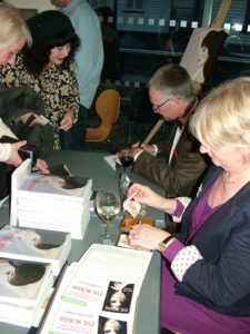 Photo of author Kevin Marsh signing copies of his thriller The Witness. Kevin took pre-orders and assessed the number of books required for the launch and placed a print on demand order with Into Print specifically for the event.