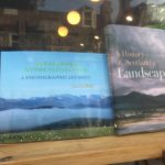 Photo through the shop window of Strathspey Myths and Legends, Chris Halliday's photo-based book.