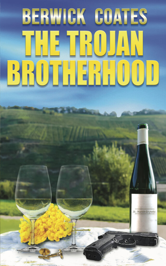 cover of The Trojan Brotherhood with hill of vines, wine bottle and glasses in the foreground